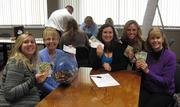 RiskSOURCE Clark-Theders holds a penny war to raise money for charity.