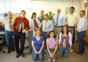 Emersion Design employees show off their ugliest ties.
