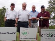 Employees at Gus Perdikakis Associates Inc. enjoy a golf outing.