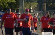 Employees at Integrated Protection Services play softball together.