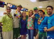 Employees at the Matrix Cos. sport Hawaiian attire for a bowling outing.