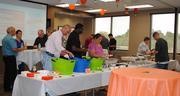 Miller-Valentine Group employees enjoy holds a Mexican buffett.