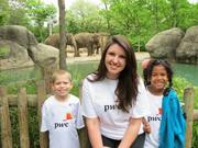 Volunteers from PwC US take children from a local elementary to the Cincinnati Zoo & Botanical Garden.