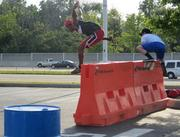 Total Quality Logistics employees tackle an obstacle course for the Urban Race.