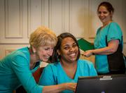 Employees at Twin Lakes retirement community share a laugh.
