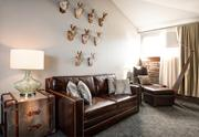 """The wall of a """"loft"""" room in the Crawford Hotel is lined with jackelopes. In-room decorations will vary but all will be designed by Denver company Nine dot Arts."""