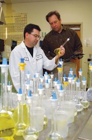 In this photo from 2001, from left, chemist Eric Madsen and Fortitech founder Walt Borisenok.