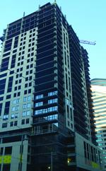 Sam Black: Opus Tower tops out; residents move into Soo Line Building apartments