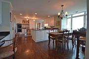 The kitchen features granite countertops, a planning desk and a breakfast room.
