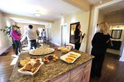 A news crew filmed a segment on flipping homes for ABC's Nightline at an open house at 1632 Logie Ave. Shown here is the kitchen and living area that was opened up during renovations by removing a wall.