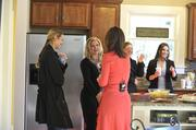 A news crew filmed a segment on flipping homes for ABC's Nightline at an open house at 1632 Logie Ave.  Rebecca Jarvis, chief business and economics correspondent for ABC News, speaks with one of the property's investors, Armella DeOrio (center).