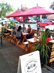 Street seating at The Portland Bottle Shop, 7960 S.E. 13th Ave.