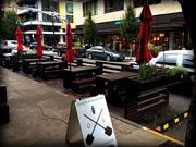 Street seating at Oven & Shaker, 1134 N.W. Everett St.