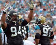 Jacksonville Jaguars defensive lineman Jeremy Mincey tries to pump up the crowd.