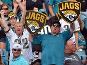 Jacksonville Jaguars fans cheer during the team's loss to the Arizona Cardinals 14-27 at EverBank Field on Sunday, Nov. 17, 2013.