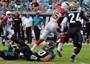 Arizona Cardinals wide receiver Michael Floyd runs past the Jacksonville Jaguars defensive players.