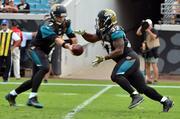 Jacksonville Jaguars running back Maurice Jones-Drew takes the handoff from the quarterback Chad Henne.