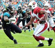 Jacksonville Jaguars safety Johnathan Cyprien tries to catch Arizona Cardinals wide receiver Andre Roberts.