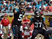 Jacksonville Jaguars linebacker Russell Allen, left, makes a defensive audible to his teammates.