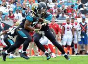 Jacksonville Jaguars running back Maurice Jones-Drew takes the ball.