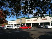 The site is currently home to the Sedgefield Shopping Center and 303 existing apartment units.