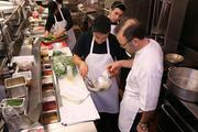 Chef Brian Binzer works with other cooks in the kitchen at Remezo Greek Cuisine in Deerfield Township.
