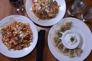 Chicken molyvos, chicken caldera and tzatziki (left to right) at Remezo Greek Cuisine.