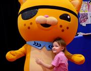 Molly Johnson of Kentucky gives a hug to a character by Costume Specialists.