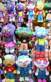 A wall of zombie dolls on exhibit at the Kelly Toy company booth.