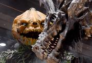 A 20-foot-high animatronic dragon and pumpkin demon by the aptly named Scare Factory demand attention from guests on the exhibit floor.