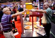 You say pizza, I say breakfast. Samples from the Noble Roman's Pizza booth are a tradition on the IAAPA convention floor.