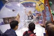 She's not a hostage. That's just a salesperson from from ABC Inflatables demonstrating the company's life-size snow globe.