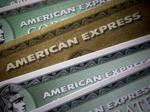 American Express leads the Dow back into record territory; new Nasdaq high