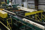 A line of poplars grown by GreenWood Resources gets processed at a Collins Companies production facility near Boardman. GreenWood struck a deal last year to supply poplar trees to Klamath Falls-based Columbia Forest Products. The partnership reduced demand for eastern U.S. hardwoods by providing the company with a local supply chain.