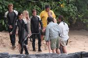 """From left, Sam Claflin as Finnick Odair, and Jennifer Lawrence as Katniss Everdeen and Josh Hutcherson as Peeta Mellark stand with the film crew from """"The Hunger Games: Catching Fire"""" at Kawela Bay near Turtle Bay Resort on the North Shore of Oahu. Many of the 300 people who worked on the movie are based in Hawaii, according to state Film Commissioner Donne Dawson."""