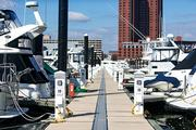 Boats docked along the Inner Harbor near the Maryland Science Center.