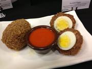 Scotch Eggs, a transplant from the Rivertowne: Two hard boiled eggs wrapped in Italian sausage.