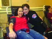 Albuquerque Police and Fire Departments  Albuquerque Fire Department Public Information Officer Melissa Romero (on donor bed) and Albuquerque Police Officer Tasia Martinez were among those taking part in the first Battle of the Badges Blood Drive Competition for United Blood Services of New Mexico. The event was held Nov. 1 and Nov. 2 at Cottonwood Mall and the Marriott Uptown. Donors would pick their favorite badge and donate on behalf of that agency. A total of 355 pints of blood were collected, which made this the largest blood drive in the history of United Blood Services New Mexico. There were 282 votes for the police officers and 283 votes for the firefighters.