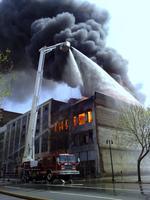 Downtown Birmingham building catches fire (Video)