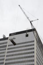 Finally, wind calms enough to hoist chiller to top of office tower