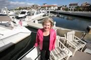 Lynda McDermott with her boat at the Westshore Yacht Club.