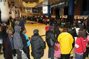 Local residents wait in line to receive free Thanksgiving meals.