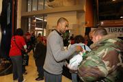 Bobcats guard Ramon Sessions distributes turkeys.