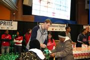 Bobcats forward Cody Zeller hands out beverages donated by Coca-Cola.