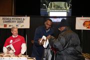 Bobcats center Al Jefferson hands out boxes of instant potatoes.