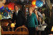 """Steve McGarrett, played by ALex O'Loughlin, and guest star Carol Burnett walk into the La Mariana Sailing Club on the Thanksgiving episode of """"Hawaii Five-0."""" The restaurant known for its tiki kitsch was featured on the show, along with Hawaii supermarket chain Foodland, and local Chef Sam Choy."""