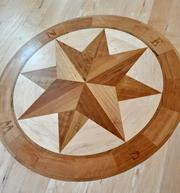 Detail from the front hall entrance, a compass design known as parquetry inlay.