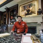 Founder of Papa John's earned slightly less in 2013