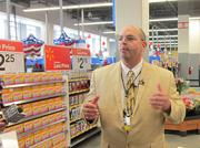 Store manager Eric Quist talks to reporters during a media preview of the Wal-Mart on H Street NW in D.C.
