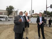 Councilmember Darryl Moore, left, said he is glad to see the project break ground after many years as Tom Bates, Berkeley mayor, and Brent Gaulke, right, look on.